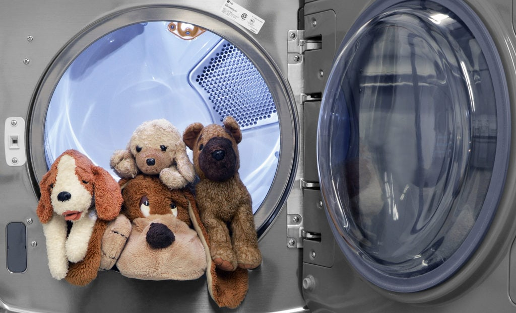 toys arranged in a washing machine