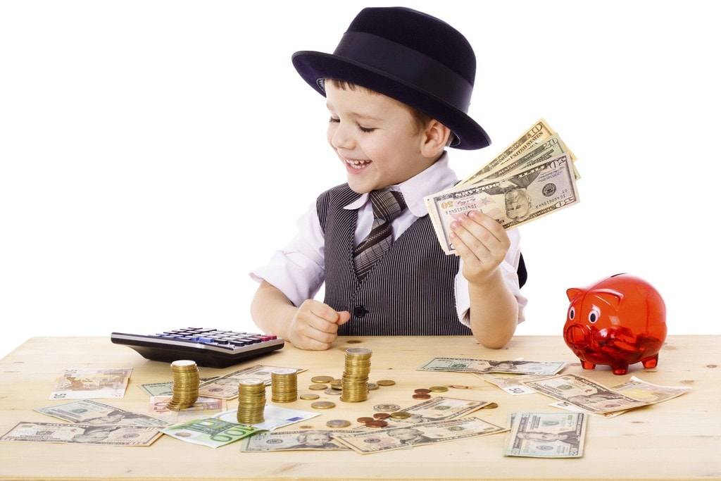 young boy calculating his savings