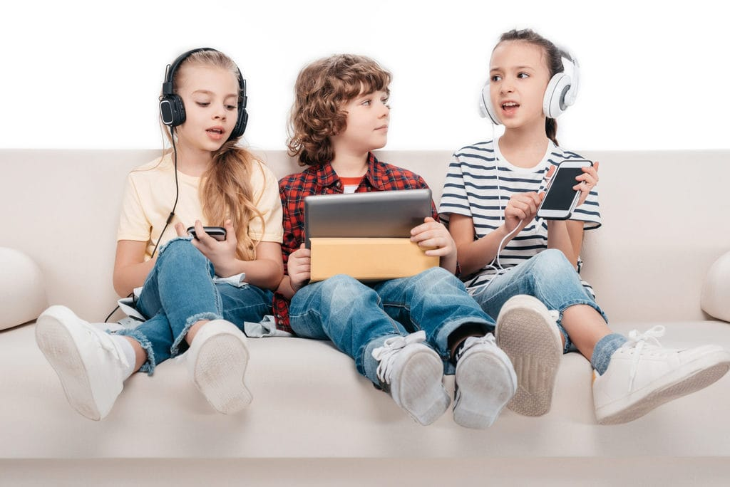 Kids listening to music and watching videos