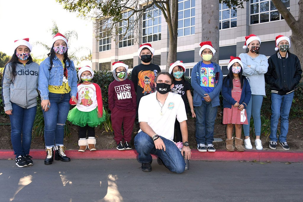 Prince Jackson posing with children during the charity event.