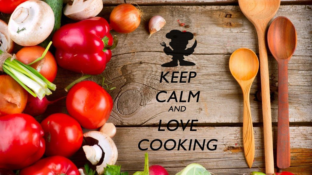 """the words """"Keep calm and love cooking"""" on top of a cooking board"""